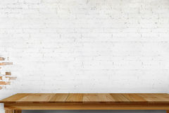 Wood table and white brick wall. For product display montage Royalty Free Stock Images