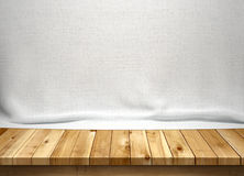 Wood table with white fabric background. For display Royalty Free Stock Images