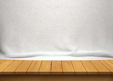 Wood table with white fabric background. For display Royalty Free Stock Photo