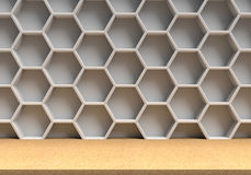 Wood table and white hexagons background Stock Image