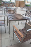 Wood tables and brown chairs Royalty Free Stock Photo