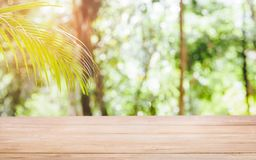 Wood tabletop on blur natural green Tropical. stock image