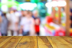 Wood tablr on shopping mall blur background with bokeh. Wood tablr on shopping mall blur background with bokeh Royalty Free Stock Photo