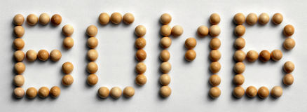 Wood Tack Word Art `Bomb`. Photograph of the word `Bomb` spelled out with wood push pins Stock Image