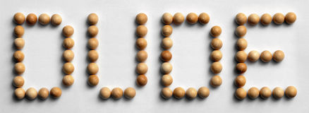 Wood Tack Word Art `Dude`. Photograph of the word `Dude` spelled out with wood push pins Stock Image