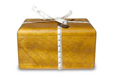 Wood And Tape Measure Bow Gift Stock Photo