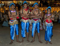 Wood Tappers wait for the start of the Esala Perahera in Kandy, Sri Lanka. Royalty Free Stock Image