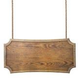 Wood tecken som hänger på repet som isoleras på vit Arkivfoton