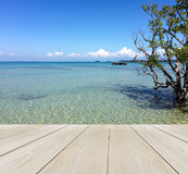 Wood Terrace on The Beach with Clear Sky and Blue Sea with Copy Space to input Text Stock Photos