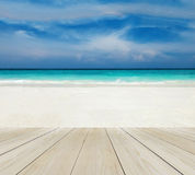 Wood Terrace on The Beach with Clear Sky, Blue Sea and Copyspace on White Sand for Mock up to Display Product or input Text. Wood Terrace on The Beach with Clear Royalty Free Stock Photo
