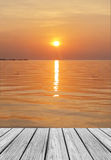 Wood Terrace on The Beach with Clear Sky and Blue Sea a Sunset Royalty Free Stock Images