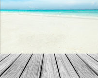 Wood Terrace on The Beach with Clear Sky,Blue Sea and White Sand to input Text Royalty Free Stock Images