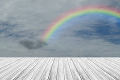 Wood terrace and Blue sky with rainbow. Wood terrace and Blue sky and white cloud with rainbow Stock Photography