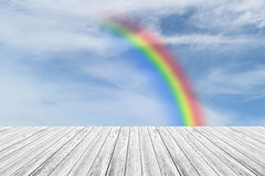 Wood terrace and Blue sky with rainbow. Wood terrace and Blue sky and white cloud with rainbow Royalty Free Stock Image