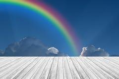 Wood terrace and Blue sky with rainbow. Wood terrace and Blue sky and white cloud with rainbow Stock Photos