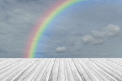 Wood terrace and Blue sky with rainbow. Wood terrace and Blue sky and white cloud with rainbow Royalty Free Stock Images