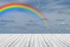 Wood terrace and Blue sky with rainbow. Wood terrace and Blue sky and white cloud with rainbow Royalty Free Stock Photos