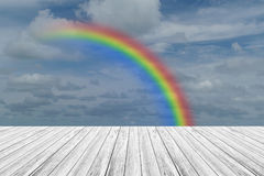 Wood terrace and Blue sky with rainbow. Wood terrace and Blue sky and white cloud with rainbow Stock Image