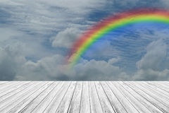 Wood terrace and Blue sky with rainbow. Wood terrace and Blue sky and white cloud with rainbow Royalty Free Stock Photo