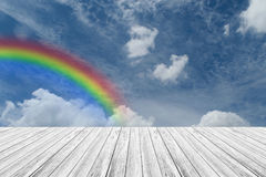 Wood terrace and Blue sky with rainbow. Wood terrace and Blue sky and white cloud with rainbow Royalty Free Stock Photography