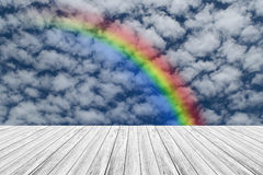 Wood terrace and Blue sky with rainbow. Wood terrace and Blue sky and white cloud with rainbow Stock Images