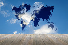 Wood terrace and Blue sky with world map Royalty Free Stock Photos