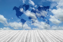 Wood terrace and Blue sky with world map. Wood terrace and Blue sky and white cloud with world map Royalty Free Stock Photography