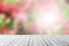Wood terrace and Blurred Beautiful Flower Royalty Free Stock Images
