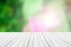 Wood terrace and Blurred Beautiful Flower Stock Image