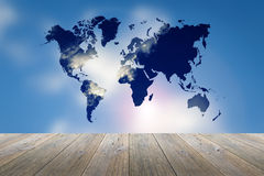 Wood terrace and blurred Blue sky with world map Stock Photography