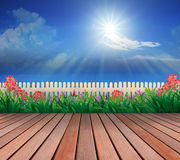 Wood terrace and flowers garden with blue sky and sunshine above Royalty Free Stock Images