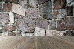 Wood terrace and stone wall Royalty Free Stock Photo