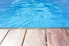 Wood terrace and swimming pool Royalty Free Stock Image