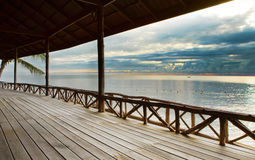 Wood terrace in wooden pavillion against peaceful of heaven sea Stock Photos