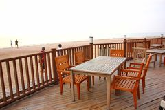 Wood terrace with wooden table and desk on beach at sea view point. The restaurant on beach ,that there are wood components stock photography