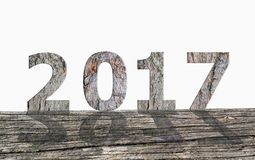 Wood text 2017. With shadow on old rustic wood floor Royalty Free Stock Photo