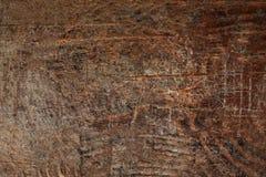 Wood textur, bryner den skrapade träskärbrädan Naturligt mörker Royaltyfri Foto