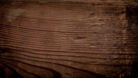 Wood textur, mörk brunt skrapade träskärbrädan naturligt Royaltyfria Foton