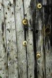 Wood textur med muttrar - och - bultar Arkivfoton
