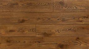 Wood texturbakgrund för design, ek tonade det bruna brädet royaltyfri foto