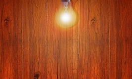 Wood texturbakgrund och ljus kula Royaltyfria Bilder
