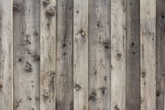 Wood texture, background of wood boards painted with stain. Background of old wooden planks,grey wooden fence, Weathered barn wood great for a background stock image