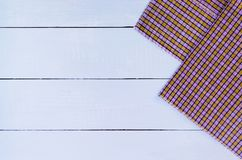 Tablecloth. Wood texture background with copy space. White Wooden table covered with tablecloth cloth checkered plaid on top view Royalty Free Stock Photos