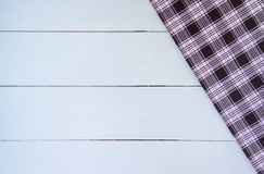 Wood table. Wood texture background with copy space. White Wooden table covered with tablecloth cloth checkered plaid on top view Stock Photography