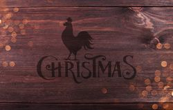 Wood Texture Background pattern with Christmas Typographical, rooster and sparking. Royalty Free Stock Image