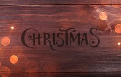 Wood Texture Background pattern with Christmas Typographical and sparking. Royalty Free Stock Image