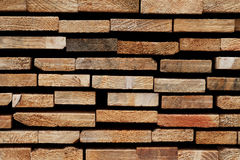Wood Texture Background: Raw Edges of Stacked Softwood Slats. Cutting edges` closeup of a wooden stack consisting of softwood slats royalty free stock images