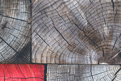 Wood texture background with a red piece Stock Photos