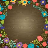 Wood texture background with various flowers Royalty Free Stock Images