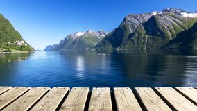 Wood Texture and Beautiful Summer Landscape Background with Norwegian Fjord, Mountains and Blue Sky